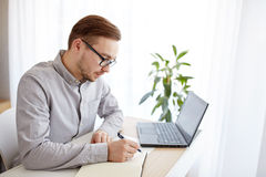 Creative man or businessman writing to notebook Royalty Free Stock Photography