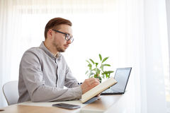 Creative man or businessman writing to notebook Royalty Free Stock Photo