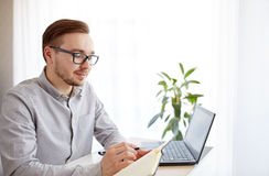 Creative man or businessman writing to notebook Stock Photography