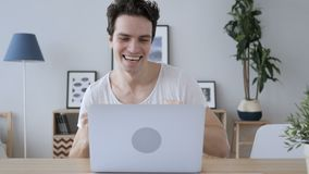 Creative man celebrating successful results at work, laptop stock video footage