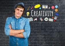 Creative man with Creativity text with drawings graphics. Digital composite of Creative man with Creativity text with drawings graphics Royalty Free Stock Images