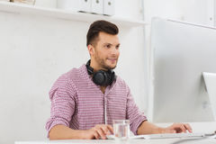 Creative man with headphones and computer Royalty Free Stock Images