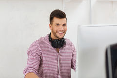 Creative man with headphones and computer Royalty Free Stock Photography