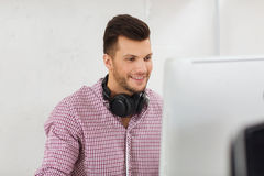 Creative man with headphones and computer Royalty Free Stock Photo