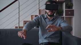 Creative man is playing in fight video game using new digital technology device of virtual reality. stock video