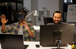 Creative man in virtual reality headset at office stock photo