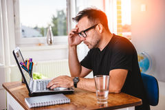 Creative man working at computer Royalty Free Stock Images