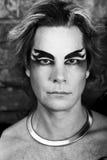 Creative man. Young handsome guy man model actor gay black angel devil. Bold fantasy daring look. Creative spectacular makeup expressive black eyebrows eyes body Royalty Free Stock Photography