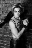 Creative man. Young handsome guy man model actor gay black angel devil. Bold fantasy daring look. Creative spectacular makeup expressive black eyebrows eyes body Stock Photo