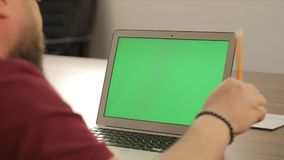 Creative manager work. Business concept. Confident young man on his laptop PC with chroma key green screen.  stock footage