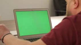 Creative manager work. Business concept. Confident young man on his laptop PC with chroma key green screen.  stock video