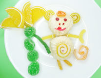 Creative marmalade fruit jelly sweet food monkey form Stock Photo