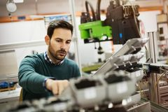 Mechanical engineer working on machines. Creative mechanical engineer working on machines royalty free stock images