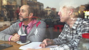 The creative meeting of two men in a cafe stock video footage