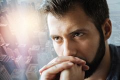 Calm serious man holding hands near mouth and looking up. Creative mentality. Calm serious unshaken man holding hands near mouth and looking up and thinking Stock Photography