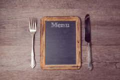 Creative menu background with chalkboard and silverware. View from above Royalty Free Stock Images