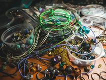 Creative mess. On the table. Jewerly Accessories for crafting stock photography