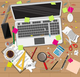 Creative mess wooden desk. chaos on table Royalty Free Stock Images