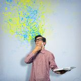 Creative mind. Image of a young man with a book, a creative mind stock image