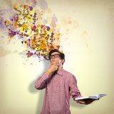 Creative mind. Image of a young man with a book, a creative mind stock photography
