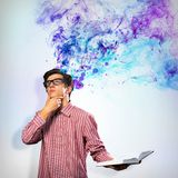 Creative mind. Image of a young man with a book, a creative mind stock images