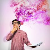 Creative mind. Image of a young man with a book, a creative mind stock photo