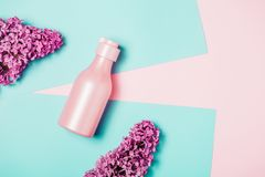 Creative minimal beauty and health background with pink bottle stock photography