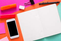 Creative minimal design - flat lay of workspace. Desk with stationery, mobile smart phone, blank sketchbook or tablet with copy space. Template, mockup, objects royalty free stock photo