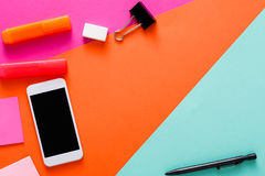 Creative minimal design - flat lay of workspace. Minimal design. Top view of modern creative workspace with various stationery and smartphone. Abstract colorful royalty free stock photo