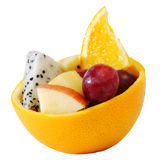 Creative mix fruit salad Served in orange rind bowl. Creativemix fruit salad Served in orange rind bowl with white isolate background royalty free stock photos