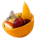 Creative mix fruit salad Served in orange rind bowl. Creativemix fruit salad Served in orange rind bowl with white isolate background stock photo