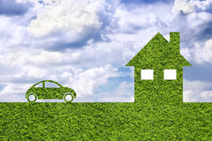 Creative modern green illustrated eco house and eco car Royalty Free Stock Photos