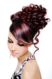 Creative multicolored hairstyle. Fashion creative hairstyle on the head of the young beautiful woman stock photography