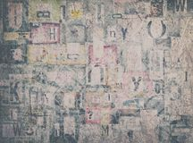 Mixed Fonts on Plywood Abstract Background. Creative multilayered backgrounds made of torn newspaper and magazine pieces Stock Photo