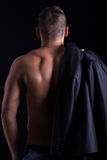 Creative muscled male model showing his back Stock Photo