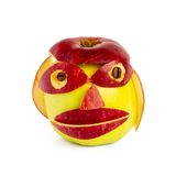 Creative muzzle from two apples of different color. Creative muzzle from two apples of yellow and red color Royalty Free Stock Photography