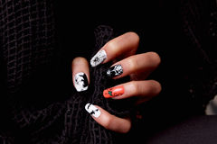 Creative nails for halloween. Manicured nails with halloween patterned nail polish stock photo