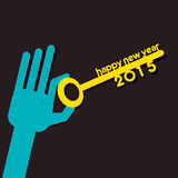 Creative new year 2015 key hold in hand Stock Photos