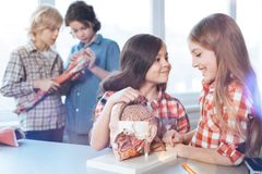 Creative observant ladies curious about human anatomy. Powerful computer. Brilliant enthusiastic nice kids fulfilling the assignment while attending biology Royalty Free Stock Image