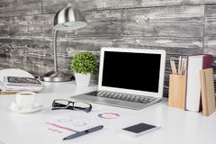 Creative office desktop with blank laptop stock photo