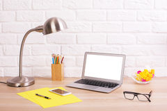 Creative office desktop with laptop Royalty Free Stock Photo