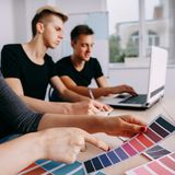 Graphic designers working with color samples royalty free stock photo