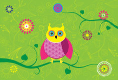 Creative owl sitting on branch with flower pattern. Stock Photos