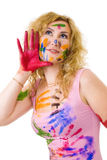 Creative painter woman. Creative young woman painter with painted face skin and clothes royalty free stock photos