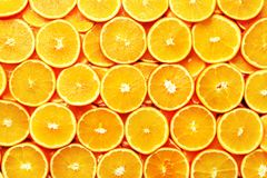 Creative pattern. Fresh sliced orange fruit texture. Macro, top view with copy space. Food frame. Juicy oranges. Background. banner royalty free stock photo