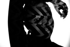 Creative pattern from projection light on beautiful woman with dark skin Stock Image
