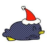 A creative penguin lying on belly wearing santa hat. An original creative penguin lying on belly wearing santa hat stock illustration
