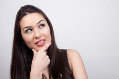 Creative pensive woman having an idea Royalty Free Stock Photo