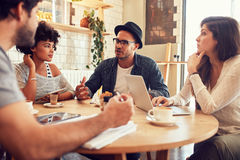 Creative people meeting at a cafe Royalty Free Stock Image
