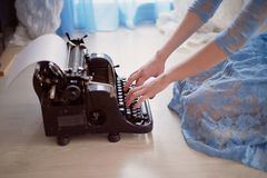 A creative person, author of books, writer of bestsellers,a journalist typing on an old typewriter. Inspiration in the Stock Photography